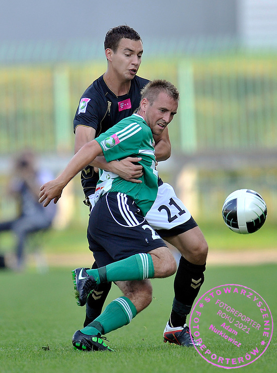 (L) MACIEJ SADLOK (POLONIA WARSAW) & (R) TOMASZ WROBEL (BELCHATOW) FIGHT FOR THE BALL DURING SOCCER MATCH POLISH T-MOBILE EXTRALEAGUE BETWEEN POLONIA WARSAW AND GKS BELCHATOW IN WARSAW, POLAND...POLAND, WARSAW , AUGUST 27, 2011..( PHOTO BY ADAM NURKIEWICZ / MEDIASPORT )..PICTURE ALSO AVAIBLE IN RAW OR TIFF FORMAT ON SPECIAL REQUEST.
