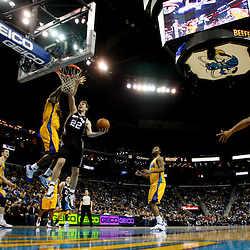 January 22, 2011; New Orleans, LA, USA; San Antonio Spurs forward Tiago Splitter (22) shoots over New Orleans Hornets center Emeka Okafor (50)during the second half at the New Orleans Arena. The Hornets defeated the Spurs 96-72.  Mandatory Credit: Derick E. Hingle