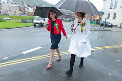 © Licensed to London News Pictures. 08/06/2017. Penygraig, Rhondda, Wales, UK. Leanne Wood, leader of the Plaid Cymru party, arrives in the pouring rain at the Soar Centre in her home town Penygraig, Rhondda in the constituency of Rhondda, to cast her vote on the day of the general election in Wales, UK. Photo credit: Graham M. Lawrence/LNP