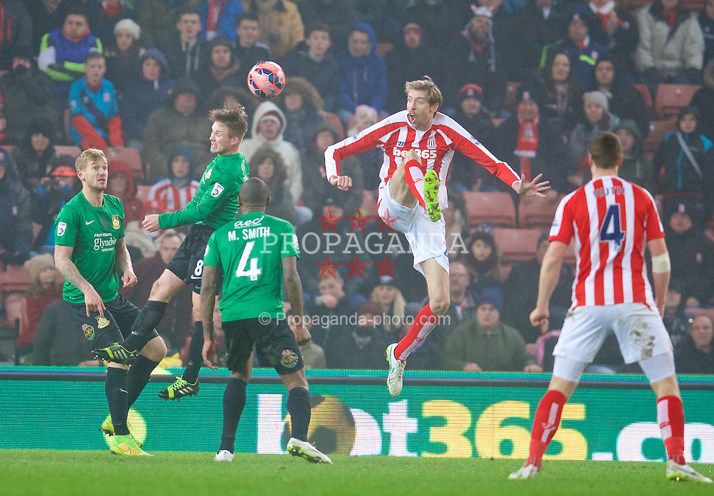 STOKE-ON-TRENT, ENGLAND - Sunday, January 4, 2015: Stoke City's Peter Crouch in action against Wrexham during the FA Cup 3rd Round match at the Britannia Stadium. (Pic by David Rawcliffe/Propaganda)