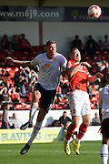 Walsall midfielder Sam Mantom and Crewe Alexandra defender Ben Nugent challenge for a header during the Sky Bet League 1 match between Walsall and Crewe Alexandra at the Banks's Stadium, Walsall, England on 26 September 2015. Photo by Alan Franklin.