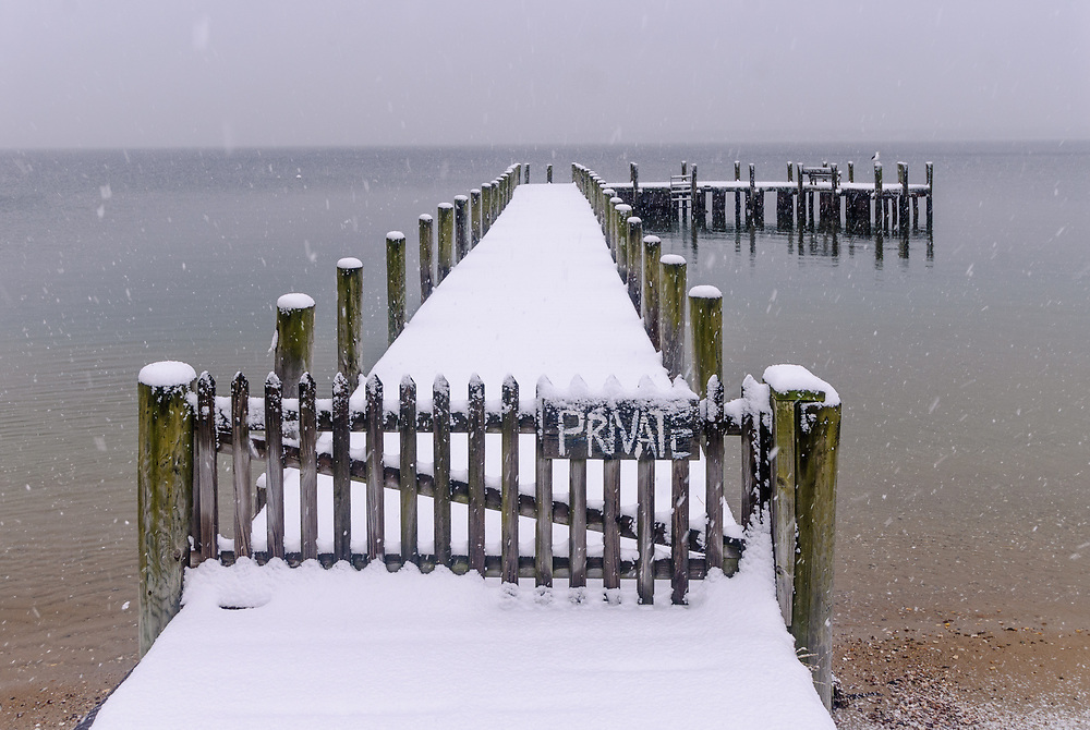 Pier in the Snow, Orient, Long Island, New York, USA