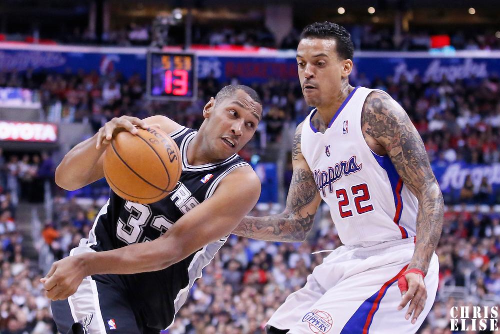 18 February 2014: San Antonio Spurs power forward Boris Diaw (33) drives past Los Angeles Clippers small forward Matt Barnes (22) during the San Antonio Spurs 113-103 victory over the Los Angeles Clippers at the Staples Center, Los Angeles, California, USA.