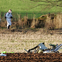 Tayside Police SOCO move in to inspect the remains of the Bell Jet Ranger 206B helicopter which crashed into a field beside the A94 Coupar Angus to Meigle road, in which two men were killed. The helicopter was being flown from Cumbernauld to Aberdeen conducting a gas pipe patrol for tthe National Grid.<br /> <br /> Picture by Graeme Hart.<br /> Copyright Perthshire Picture Agency<br /> Tel: 01738 623350  Mobile: 07990 594431