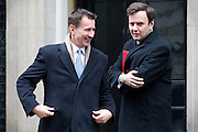 UNITED KINGDOM, London: 1 March 2016. Health Secretary Jeremy Hunt (L), Chief Secretary to the Treasury Greg Hands (R) leaves Downing Street after attending Cabinet meeting in central London.  Pic by Andrew Cowie / Story Picture Agency
