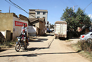 CHENGGONG, CHINA -China Out - Finland Out<br /> <br /> Ghost City <br /> <br /> People make their way at a village on November 21, 2013 in Chenggong, Yunnan Province of China. Chenggong is a satellite city located just south of Kunming. As of 2012, much of the newly constructed housing in Chenggong is still unoccupied, and it is reportedly one of the largest ghost towns in Asia. According to a China Youth Daily report in July, at least 12 such ghost cities across the country have been found. Besides the best known of these - Ordos in North China's Inner Mongolia Autonomous Region, the list also included Changzhou in Jiangsu, Zhengdong New Area in Henan Province, Shiyan in Hubei and Chenggong District of Kunming in Yunnan. <br /> ©Exclusivepix