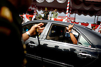 "Former Army General Soenarko holds up a ""number one"" finger out the car window as he departs his post after a general handover event in Banda Aceh, Indonesia, on Nov. 20, 2009. ..Since the signing of Helsinki peace accord in 2005 that ended the longest conflict in Indonesia between the Free Aceh Movement and Indonesian government, the country has pulled out more then 20,000 troops from the province. The army base in Banda Aceh currently has about 15,000 soldiers."