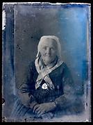 senior woman vintage portrait wearing a cap circa 1920s France Normandy