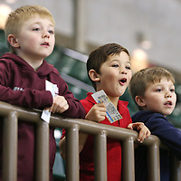 Lauren Wood | Buy at photos.djournal.com<br /> Cousins Maciah Morgan, 7, from left, Zane Karter Eldridge, 5, and Elijah Morgan, 6, all watch the Ole Miss vs. Mississippi State hockey game Wednesday night at the BancorpSouth Arena. Maciah was rooting for the Bulldogs while Zane and Elijah were cheering for the Rebels.