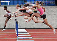 Runners including Pine Bush's Amber Passalaqua, far right,  and Newburgh's Dotrine Jacobs, far left, compete in the 100-meter hurdles during the Hudson Valley Region qualifier for the Empire State Games at Middletown on Monday, June 14, 2010.