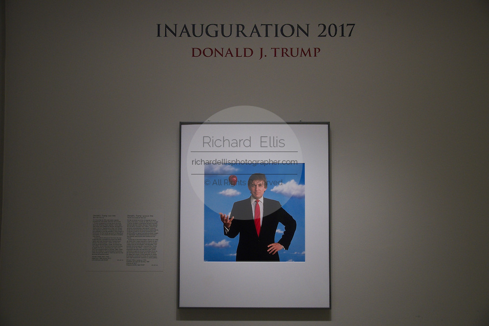 Photographic portrait of Donald Trump tossing a red apple by photographer Michael O'Brien on display for the Inauguration at the National Portrait Gallery art museum, part of the Smithsonian Institution housed in the historic Old Patent Office Building in Washington, DC. The portrait was donated to the gallery in 2011 and was put on display to mark his becoming the 45th president.