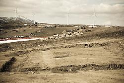 """Corleto Perticara (PZ) 17.02.2009, Italy - Tempa Rossa - Speranze e realtà del giacimento Total in Basilicata. Nelle immediate vicinanze del luogo dove dovrebbe sorgere il Centro Oli, è situata una vasta area archeologica. Il Direttore Regionale per i beni Culturali e Paesaggistici della Basilicata, con decreto dell'8 settembre 2004 dichiarava di interesse archeologico particolarmente importante l'area e la sottoponeva ai vincoli previsti dal decreto legislativo n. 42/2004. Detti vincoli, in pratica, consistono nel mantenere l'attuale assetto agricolo dei terreni, con esclusione di qualsiasi altra attività, compresa la messa a dimora di colture arboree. Alla base dell'adozione del decreto vi è la relazione scientifica, a firma del dott. Marcello Tagliente, della Soprintendenza per i Beni Archeologici della Basilicata, secondo la quale in località Tempa Rossa vi sarebbe la presenza di un """"importante sito archeologico"""" dove sono state riscontrate due aree, correlate tra loro e caratterizzate da una particolare concentrazione di frammenti ceramici e tegole databili tra il VI ed il IV secolo a. C. da mettere in relazione con una necropoli Enotria ed un esteso impianto rurale di età lucana. In seguito vengono effettuate nuove indagini della Soprintendenzaci si accorge che il sito non è poi tanto importante e si procede ad una nuova perimetrazione dell'area sottoposta a vincolo che non interferisce più con il progetto della società petrolifera. NELLA FOTO: La zona archeologica vicino il cantiere Total di Tempa Rossa."""