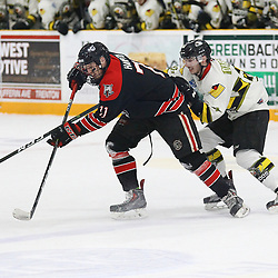 """TRENTON, ON  - MAY 5,  2017: Canadian Junior Hockey League, Central Canadian Jr. """"A"""" Championship. The Dudley Hewitt Cup Game 7 between Georgetown Raiders and the Powassan Voodoos.   Jonathan Hampton #71 of the Georgetown Raiders and  Dylan DAgostino #81 of the Powassan Voodoos battle for position during the first period<br /> (Photo by Alex D'Addese / OJHL Images)"""