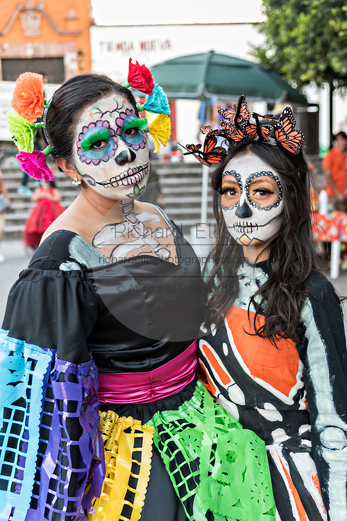 Young Mexican women dressed in La Calavera Catrina costume for the Day of the Dead or Día de Muertos festival October 29, 2017 in San Miguel de Allende, Guanajuato, Mexico. The festival has been celebrated since the Aztec empire celebrates ancestors and deceased loved ones.