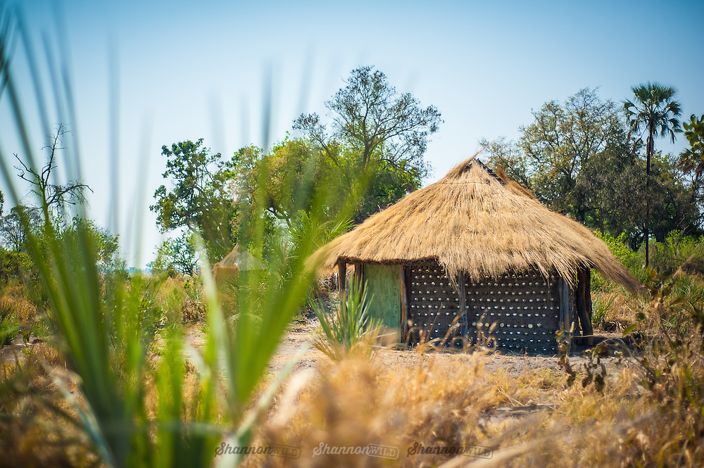 "The village of Sedibana (Saweto for ""water well"") consists of circular homes out of the termite clay with aluminium cans stacked neatly throughout the clay for added stability and a thatched roof made of Delta reeds and hippo grass."