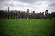 Central Park visitors use a break in the weather to play toss and catch a run.