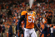 Denver Broncos middle linebacker Wesley Woodyard (52) walks on the field  spitting water the Kansas City Chiefs against the Denver Broncos in an NFL football game Sunday, Nov. 17, 2013 in Denver, Colorado.  (AP Photo/Tom Hauck)