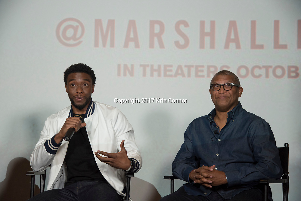 Actor Chadwick Boseman and Director Reginald Hudlin speak during a Q&A session with Roland Martin after a screening of Open Road Films' new movie MARSHALL at in Baltimore, Md. on July 25th, 2017. (Photo by Kris Connor/Open Road Films)