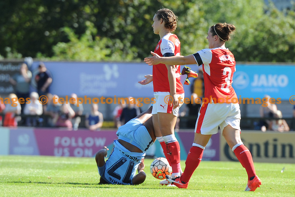 Manchester City Nikita Parris manages to retain possession despite presure from Arsenals Josephine Jenning during the The FA Women's Super League 1 match between Arsenal Ladies and Manchester City Women at Boreham Wood FC. September 11, 2016.<br />