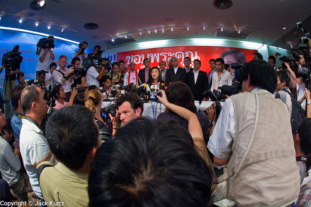03 JULY 2011 - BANGKOK, THAILAND:  YINGLUCK SHINAWATRA, (seated center) the Prime Minister elect of Thailand, is flanked by her advisors while she announces her victory in the Thai elections during a press conference Sunday night. If her election holds she will be the first woman elected Prime Minister of Thailand. Yingluck Shinawatra and the Pheu Thai Party scored a massive landslide win in the Thai election Sunday. Pheu That is estimated to have won more than 300 seats in Thailand 500 seat parliament, so they won an absolute majority and could govern without having to form a coalition with minor parties. Pheu Thai is the latest incarnation of deposed former Prime Minister Thaksin Shinawatra's political party. Yingluck is his youngest sister. Many observers expect legal challenges to the Pheu Thai victory and the election does not completely resolve Thailand's difficult political history of the last five years.    PHOTO BY JACK KURTZ