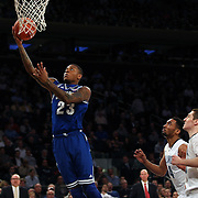 Fuquan Edwin, Seton Hall, drives to the basket during the Villanova Wildcats Vs Seton Hall Pirates basketball game during the Big East Conference Tournament at Madison Square Garden, New York, USA. 12th March 2014. Photo Tim Clayton