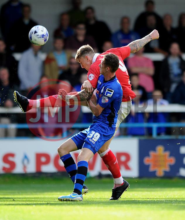 Bristol City's Aden Flint clears the ball from danger under pressure from Rochdale's Joe Bunney - Photo mandatory by-line: Dougie Allward/JMP - Mobile: 07966 386802 23/08/2014 - SPORT - FOOTBALL - Manchester - Spotland Stadium - Rochdale AFC v Bristol City - Sky Bet League One