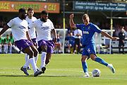 AFC Wimbledon attacker Marcus Forss (15) shoots at goal during the EFL Sky Bet League 1 match between AFC Wimbledon and Shrewsbury Town at the Cherry Red Records Stadium, Kingston, England on 14 September 2019.