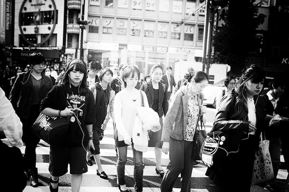 TOKYO, JAPAN - OCTOBER 20 : A pedestrian walks in Shinjuku district Tokyo, Japan on October 20, 2015. <br /> <br /> Photo: Richard Atrero de Guzman