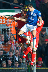 LIVERPOOL, ENGLAND - Saturday, February 6, 2010: Liverpool's Sotirios Kyrgiakos and Everton's Tim Cahill during the Premiership match at Anfield. The 213th Merseyside Derby. (Photo by: David Rawcliffe/Propaganda)