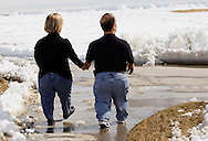 Chris Kotzian (R) and wife Barb walk in a park near their home in Thornton, Colorado March 25, 2010.  Both about four-feet-tall,  the Kotzians are both achondroplasia dwarfs, a rare genetic disorder of bone growth.  Preferring to be called little persons they both are active in the Little People of America, the only dwarfism support organization that includes all 200+ forms of dwarfism.  REUTERS/Rick Wilking (UNITED STATES)