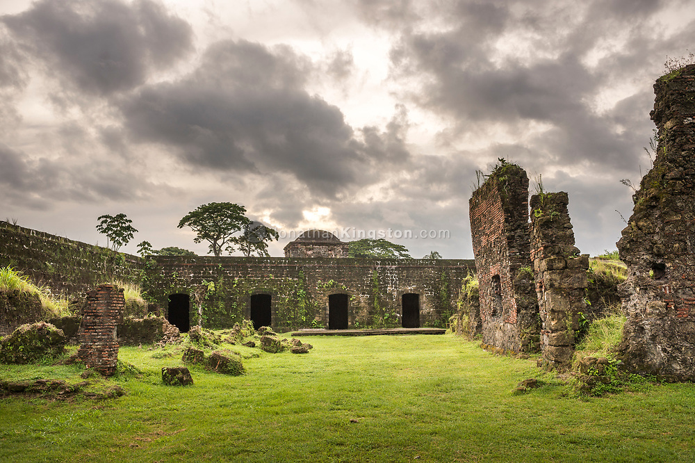 Low angle view of Fort San Lorenzo, Panama under dramatic clouds.