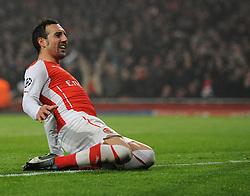 Arsenal's Santi Cazorla celebrates Arsenal's Alexis Sanchez's goal - Photo mandatory by-line: Dougie Allward/JMP - Mobile: 07966 386802 - 26/11/2014 - SPORT - Football - London - Emirates Stadium - Arsenal v Borussia Dortmund - Champions League - Group D