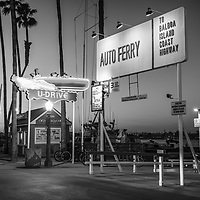 Balboa Island Auto Ferry sign in Newport Beach California. The auto ferry carries passengers from Balboa Peninsula to Balboa Island in Orange County Southern California. Photo is black and white and high resolution. Copyright ⓒ 2017 Paul Velgos with All Rights Reserved.