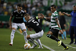 September 20, 2018 - Lisbon, Portugal - Raphinha of Sporting (R) vies for the ball with Maksim Medvedev of Qarabag FK (C) and Mahir Madatov of Qarabag FK (L)  during Europa League 2018/19 match between Sporting CP vs Qarabagh FK, in Lisbon, on September 20, 2018. (Credit Image: © Carlos Palma/NurPhoto/ZUMA Press)