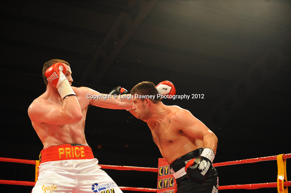 David Price (red/white shorts) defeats Sam Sexton in a 12x3 contest to claim the British & Commonwealth, Heavyweight Title at the Aintree Equestrian Centre, Liverpool on the 19th May 2012. Frank Maloney Promotions © Leigh Dawney Photography 2012.
