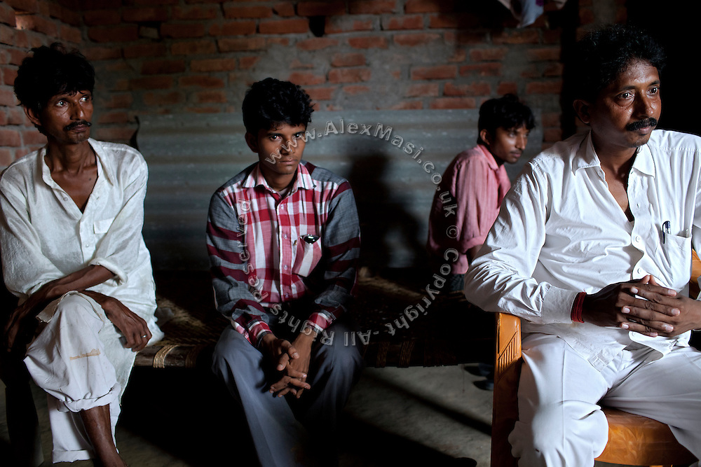 The father of Kanchan Kumari Sharma, 12, (name changed) Raja Kumar Sharma, 45, (left) a barber, earning around 150 INR a day, (3 USD) is sitting with his brother-in-law, Santosh Kumar, Verma, 42, a small businessman dealing in rice and wheat. With them are Kanchan's eldest brother Avesh Sharma, 24 (second from right) and her older one, Ashok Sharma, 19. (second from left) In 2012, Kanchan went with a friend to bring lunch to her father, around 2 km away from her home. On the way they met Rajesh (rapist) and Ashok, a friend of his. Both girls were picked up on the spot using an excuse. Ashok drove Kanchan's friend home, but Rajesh forced Kanchan to travel with him during six days and for hundreds of kilometres across different states. (Mirzapur / Chennai / Itarsi / Bhusawal) He raped her once behind the station in Itarsi. With great effort and some coincidence, the uncle of Kanchan managed to bring her back home. Although she was scared, she insisted on going to the police to file a case (FIR). She was kept at the police station for 12 days and threatened to prevent her from filing an official case. Ashok and Rajesh are from higher caste and wealthy families. While Rajesh spent 24 days in jail initially in summer 2012, he is now a free man while the trial is still going on. Kanchan's family is now struggling to put together 30.000 Indian Rupees (500 USD) to continue battling for justice in court.