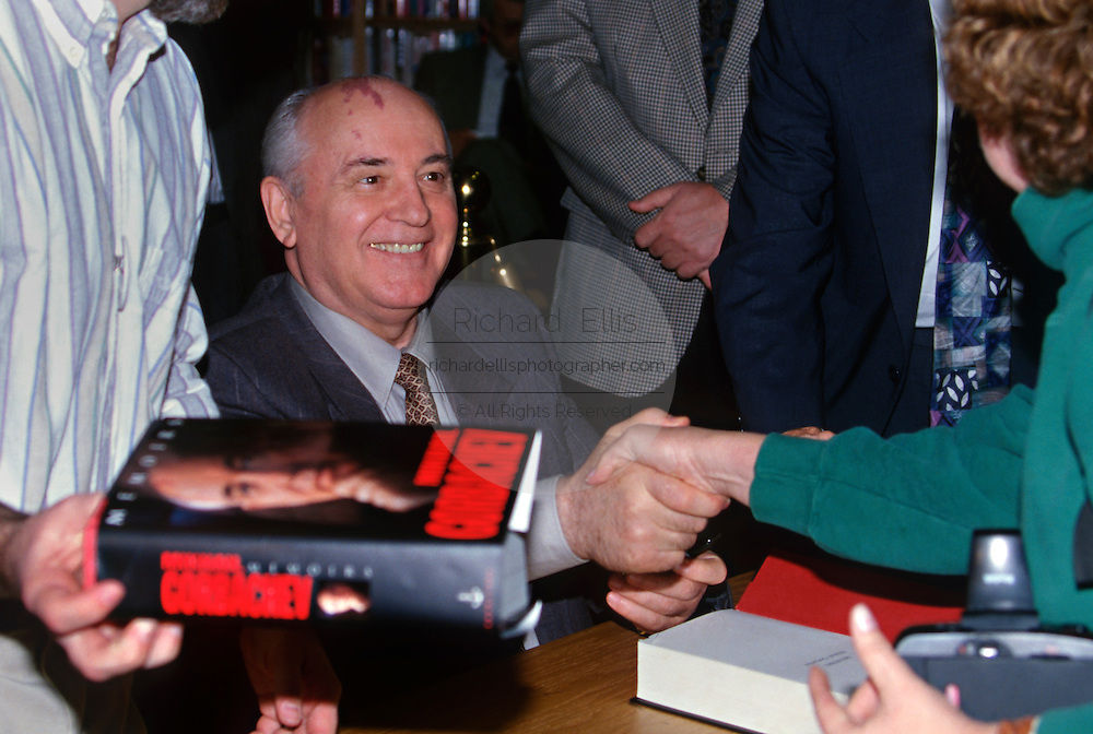 Former Soviet leader Mikhail Gorbachev signs copies of his book at Politics and Prose bookstore October 25, 1996 in Washington, DC.