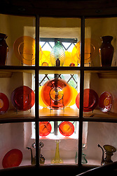 Coloured glass collection in the Tower at Sissinghurst Castle Garden