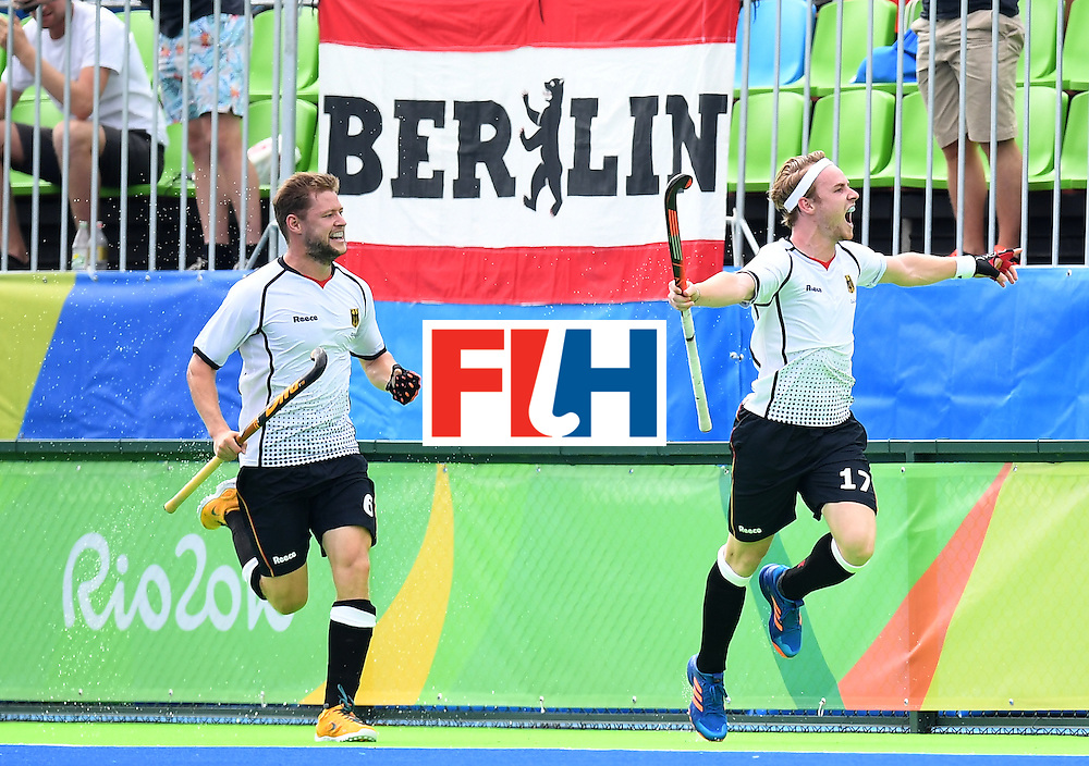 Germany's Christopher Ruhr (R) celebrates scoring a goal during the men's field hockey Germany vs India match of the Rio 2016 Olympics Games at the Olympic Hockey Centre in Rio de Janeiro on August, 8 2016. / AFP / MANAN VATSYAYANA        (Photo credit should read MANAN VATSYAYANA/AFP/Getty Images)