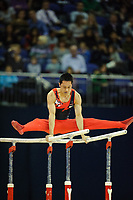 Keneth IKADA (CAN), competes in the parallel bars, The London Prepares Visa International Gymnastics