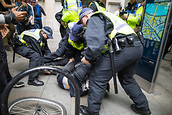 "© Licensed to London News Pictures . 24/06/2017. London, UK. Police detain an anti fascist on Northumberland Avenue . The English Defence League ( EDL ) hold a March on Parliament , from Charing Cross to Victoria Embankment , opposed by  a counter demonstration by Unite Against Fascism . Scotland Yard said it was using public order laws to restrict the marches ""due to concerns of serious public disorder, and disruption to the community"" following terrorist attacks in Manchester , Westminster and Finsbury Park and the Grenfell Tower fire  . Photo credit: Joel Goodman/LNP"