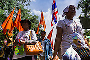 16 MAY 2014 - BANGKOK, THAILAND:  Anti-government protestors march to the Thai parliament complex. Thousands of protestors from the People's Democratic Reform Committee (PDRC) surrounded the Thai Parliament complex Saturday to pressure the Thai Senate to select an interim Prime Minister to replace ousted former PM Yingluck Shinawatra. The Senate decided not to appoint an interim PM of their own and announced a meeting with the current interim Prime Minister. The protestors left the parliament complex and threatened to return in larger numbers if the Senate doesn't act. The Senate appointment of an acting PM could plunge Thailand into chaos since there is already an interim Prime Minister from the ruling Pheu Thai party.    PHOTO BY JACK KURTZ
