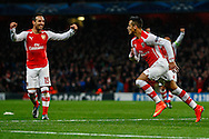 Alexis Sanchez of Arsenal (right)  celebrates after he scores Arsenal'a second goal to make it 2-0 while Santi Cazorla of Arsenal (left) congratulates him during the UEFA Champions League match at the Emirates Stadium, London<br /> Picture by David Horn/Focus Images Ltd +44 7545 970036<br /> 04/11/2014