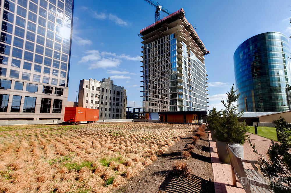 View of One Light Tower construction progress in downtown Kansas City from green roof in the Power & Light District. April 3, 2015.