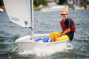 Young Harry smiles for the camera while he sails his Optimist as part of the Wickford Sailing Association's summer sailing program.