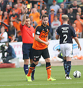 Referee Steven McLean yellow cards Dundee United's Keith Watson - Dundee v Dundee United, SPFL Premiership at Dens Park<br /> <br />  - &copy; David Young - www.davidyoungphoto.co.uk - email: davidyoungphoto@gmail.com