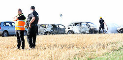 Winchester,Hampshire Friday 12th august <br /> <br /> Up to 80 cars have been destroyed in a massive fire at BoomTown Fair near Winchester.<br /> <br /> One of the festival's campsites was evacuated as firefighters battled the enormous blaze in the west car park.<br /> <br /> Huge plumes of black smoke billowed over the site and were visible from as far as Winchester city centre.<br /> <br /> No casualties have been reported.<br /> <br /> The blaze erupted at around 4.15pm and took over an hour to get under control. The flames are now out.<br /> <br /> <br /> South Central Ambulance Service said around 80 vehicles are burnt out, though Hampshire Fire and Rescue Service put the estimate at 60.<br /> <br /> Firefighters sent six pumps to the scene and are still advising people to avoid the area.<br /> <br /> The 'Boomtique' campsite was evacuated as a precaution, according to Hampshire Fire and Rescue Service.<br /> Crews from Winchester, Eastleigh, Redbridge, St Mary&rsquo;s, Alresford, Beaulieu and Bishop's Waltham attended.<br /> <br /> Paramedics were on the scene but have not reported any casualties. South Central Ambulance Services hailed the &quot;great joint working from all emergency responders&quot;.<br /> <br /> Firefighters stood among row after row of burnt-out vehicles for their debrief, with festivalgoers barred from the area until the flames are dampened down.<br /> <br /> Hampshire Constabulary are set to assist with the investigation. It will take &quot;a few days&quot; to establish the cause, a fire service spokesman said.<br /> <br /> BoomTown does not sell single day passes, so only a handful of ticketholders required travel out of the festival last night.<br /> <br /> Dozens of music fans were searching for last-minute tickets on social media last night despite the drama. <br /> <br />    Poor mobile signal on site hindered festivalgoers trying to contact insurers and relatives. <br /> <br /> The incident caused huge delays on the A31 and surrounding roads as motorists slowed down to look at the smoke.&copy;UKNIP