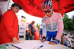 Simon Spilak of Slovenia (Lampre) signing the start list before the 3rd stage of the 15th Tour de Slovenie from Skofja Loka to Krvavec (129,5 km), on June 13,2008, Slovenia. (Photo by Vid Ponikvar / Sportal Images)/ Sportida)