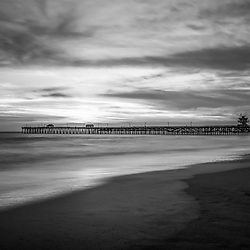 San Clemente pier black and white photo in Orange County Southern California. San Clemente is a popular beach city in the Western United States of America. Copyright ⓒ 2017 Paul Velgos with all rights reserved.