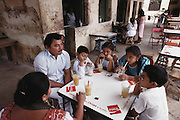 Sr. Muna and his family having drinks at a cafe, Yucatan, Mexico.